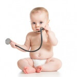 cute baby girl with stethoscope in hands